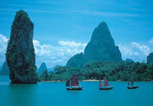 The romance and beauty of the Phang Nga Bay are yours to enjoy from the deck of the June Bahtra.